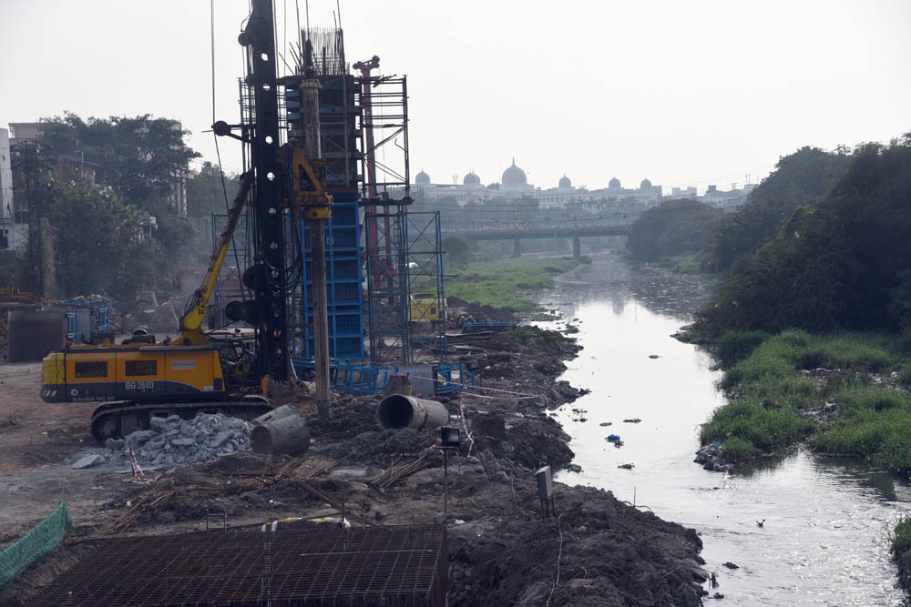 Metro Train work on the bed of Musi River